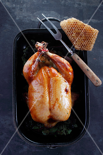 Roast chicken with honey in a black dish