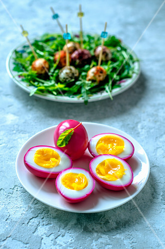 Chicken eggs, painted beet juice, quail eggs in a variety of spices and arugula