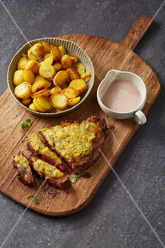 Beef steak with a handmade sour milk cheese crust and fried potatoes
