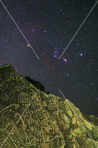 Orion above Native American petroglyph