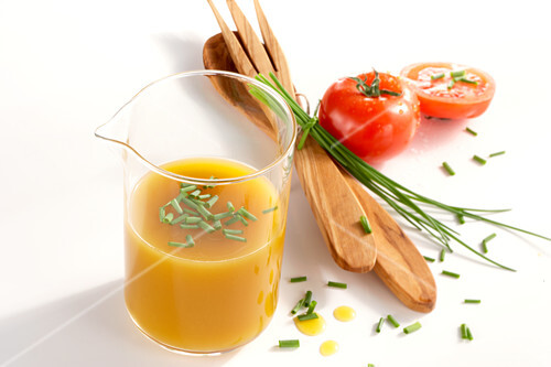 Homemade natural mango vinegar with chives and tomatoes