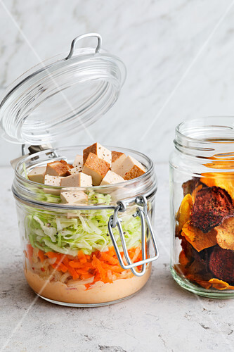 Coleslaw with vegetable crisps in jars