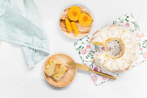 Yoghurt and peach Bundt cake with coconut oil, sliced