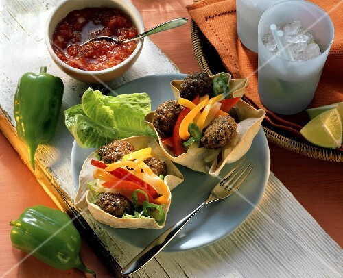 Tortilla bowls filled with meat balls and vegetables
