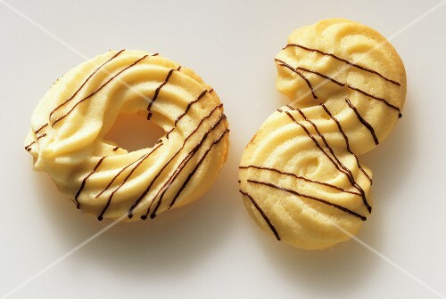 Piped biscuits, one ring-shaped, one 'S'-shaped