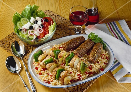 Cevapcici, shashlik kebabs on paprika rice & peasant's salad