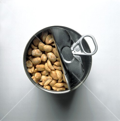 Opened tin of peanuts, from above