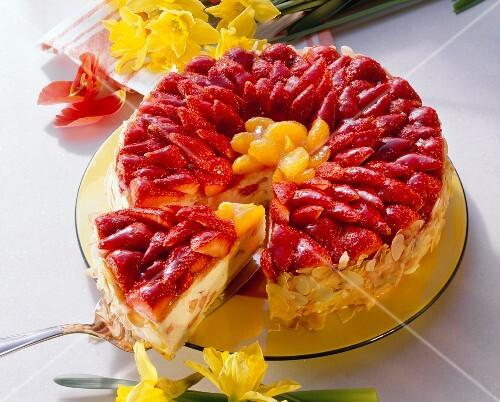 Strawberry and mandarin cream gateau, a piece cut