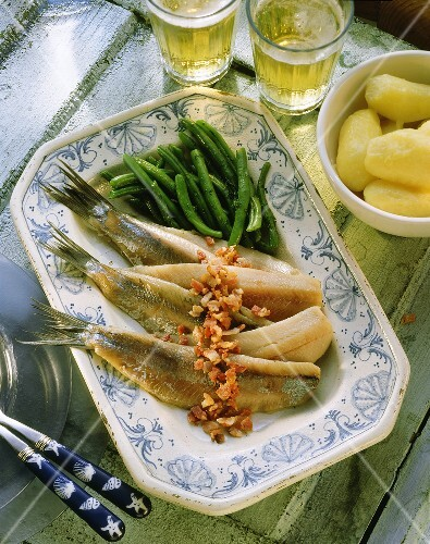 Matjes herrings with bacon & green beans on serving dish