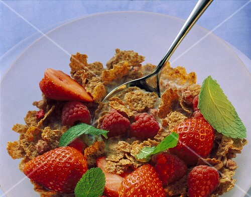 A bowl of wholemeal cornflakes, strawberries & raspberries