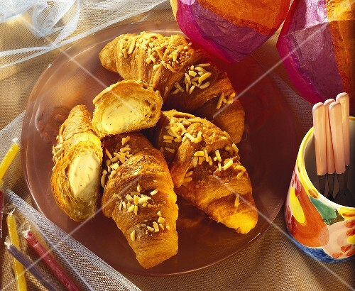 Hot croissants with icecream filling for children's Carnival