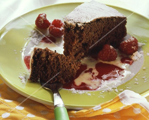 Delicate chocolate nut cake with raspberry & vanilla sauce