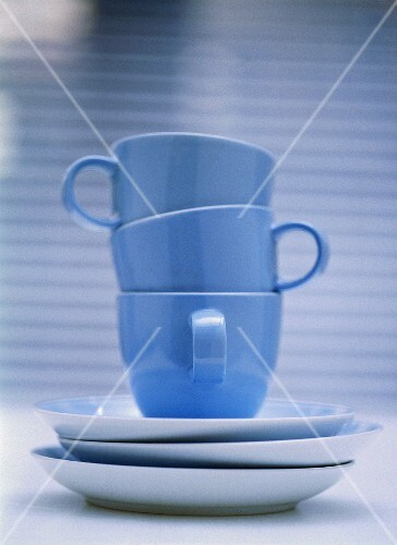Three pale-blue coffee cups stacked inside each other