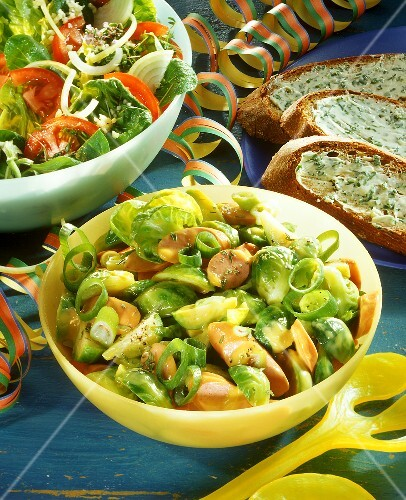 Brussels sprout salad with Viennese sausages
