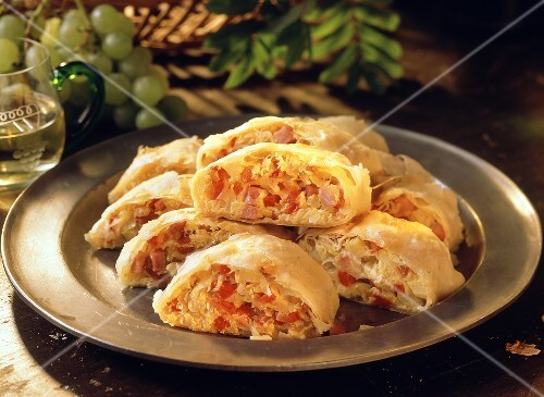 Several pieces of sauerkraut strudel with bacon & ham