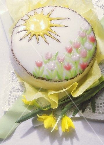 Decorated spring cake with iced tulips & sun