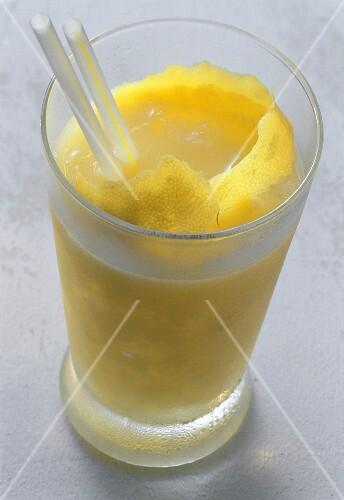 Mango cocktail with lemon peel