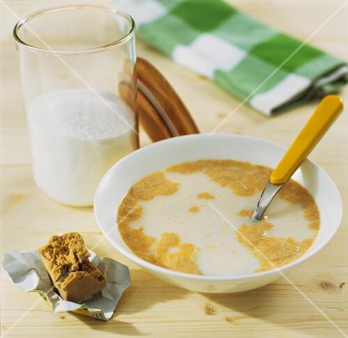 Dissolving yeast in sweetened luke-warm milk