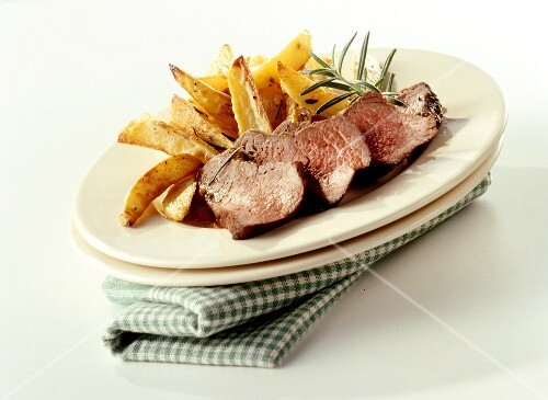 Marinated ostrich fillet with potato wedges