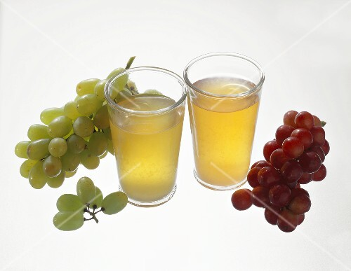 Must from red and white grapes in glasses