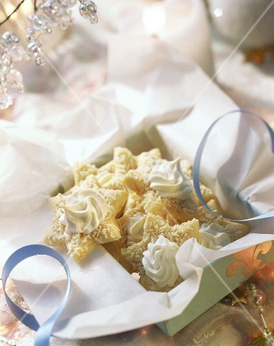 Coconut stars with meringue rosettes in gift box