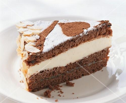 A piece of chocolate gateau with vanilla mascarpone cream