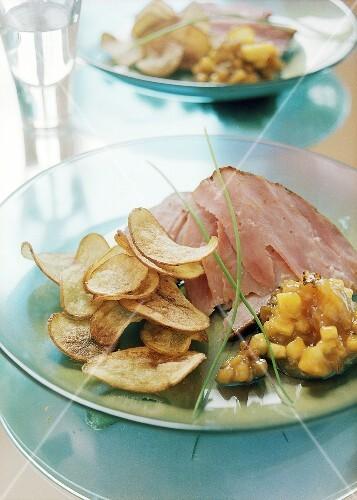 Ham with sweet potato crisps and aubergine chutney