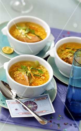 Alphabet soup with duck breast in soup cups