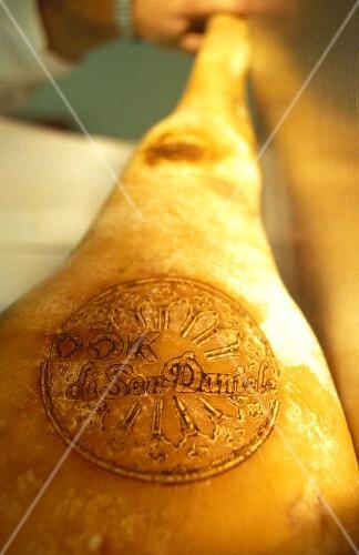 San Daniele ham with branded quality seal