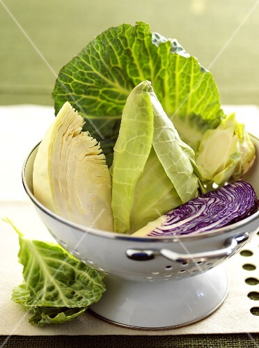 Various types of cabbage in a strainer