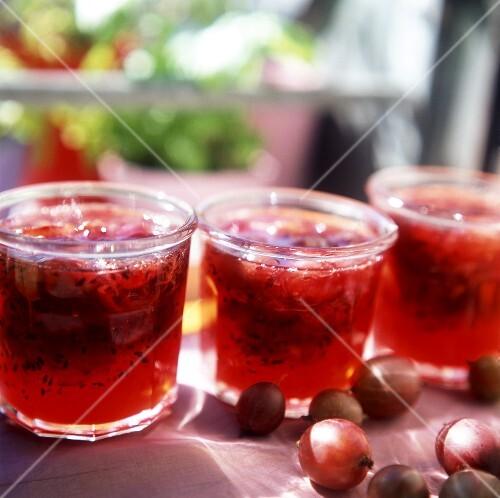 Red gooseberry jam in preserving jars
