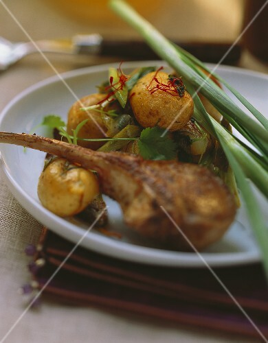 Lamb chop and baked potatoes with spices and herbs
