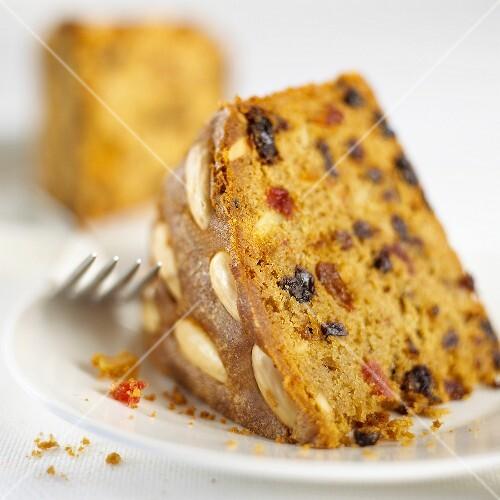 A piece of Dundee cake (Scottish fruit cake)