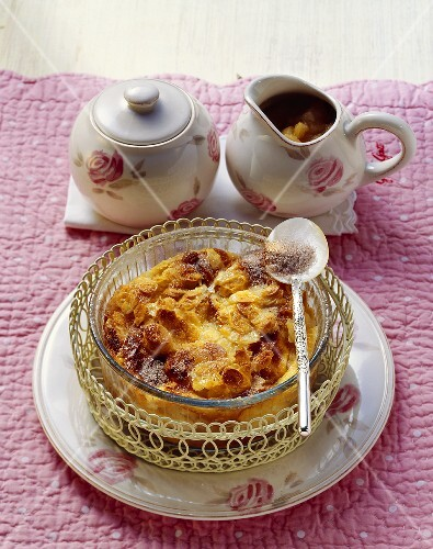 Hot bread pudding with flaked almonds and apple puree