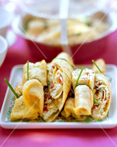 Omelette rolls with spicy rice filling