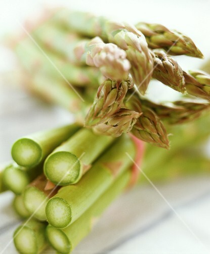 Two bundles of green asparagus (detail)