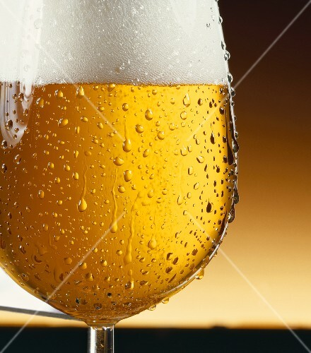Pils in glass with drops of water (detail)