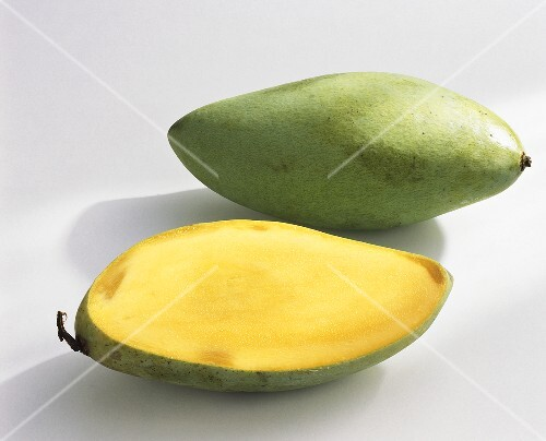 Mangos, variety 'Nam Dok Mai', whole and halved