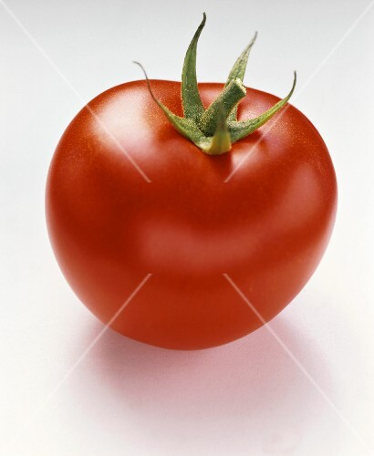 A tomato on white background