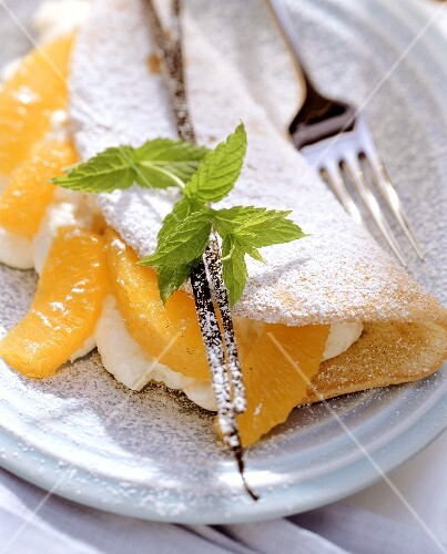 Sponge omelette with orange mousse, orange segments & mint