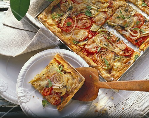 Vegetable pizza with fennel, tomatoes, onions, mushrooms