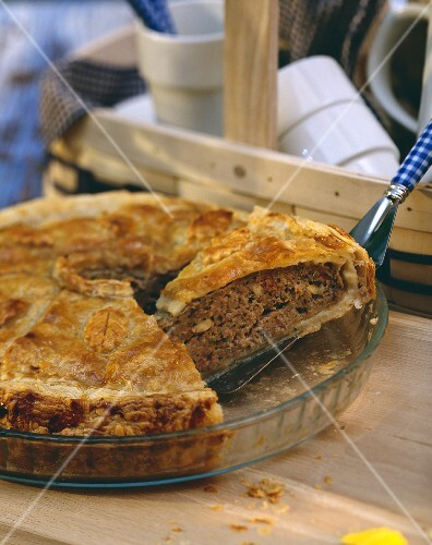Mince and mushroom quiche with a piece lifted up