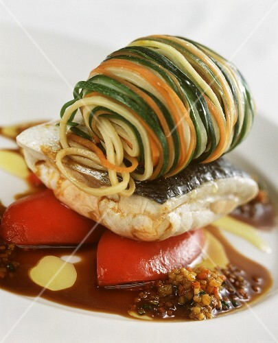 Bream with vegetable noodles on plate