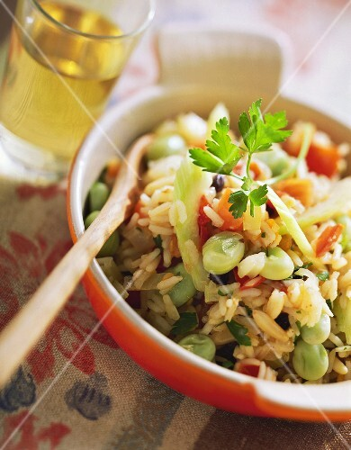 Pilau with vegetables and fresh parsley in gratin dish