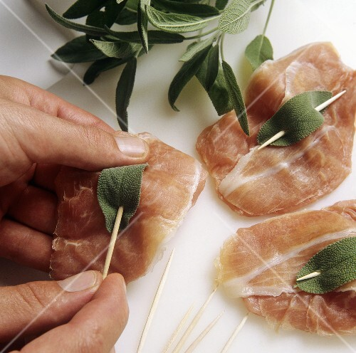 Attaching sage leaves to veal escalope