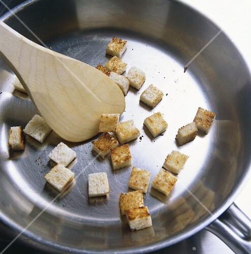 Frying croutons in a frying pan