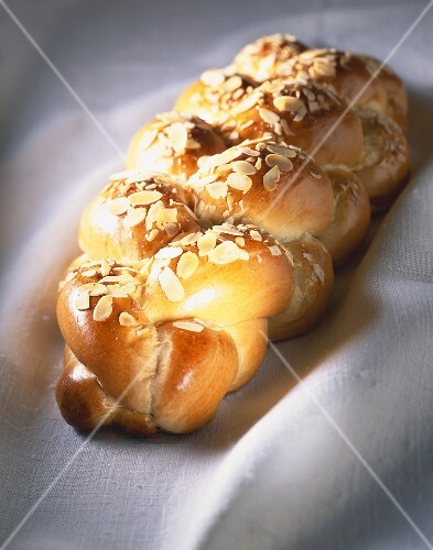 Bread plait with flaked almonds