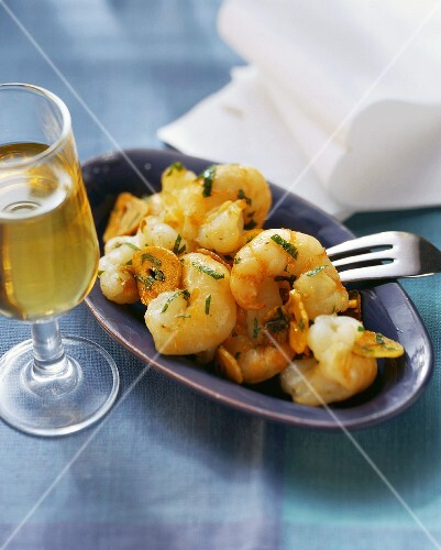 Shrimps in garlic with parsley; sherry glass