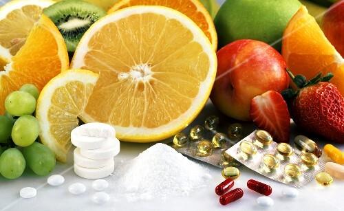 Fresh fruit, vitamin tablets and powder