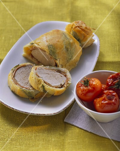 Pork fillet in sage puff pastry and braised tomatoes
